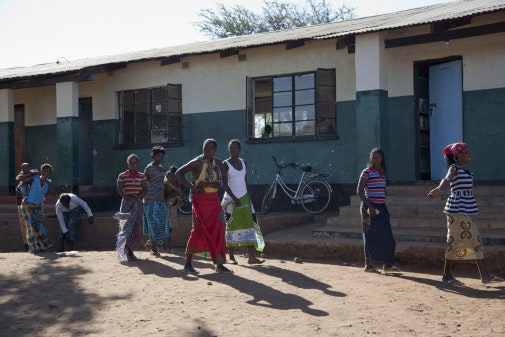 A group of women singing outside in Smonga