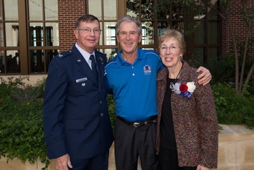 """President Bush, Colonel Charles """"Chuck"""" DeBellevue, USAF (Ret), and his wife Sally."""