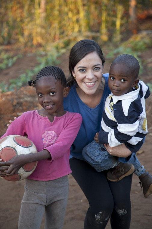 Melanie Enriquez with two new friends in Zambia